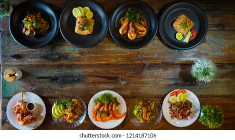 Thai fusion food on wooden table top view