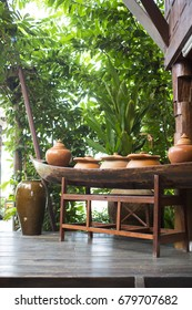 Thai garden decoration with a wood boat and clay pot