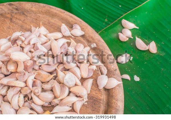Thai garlic on banana leaf by top view