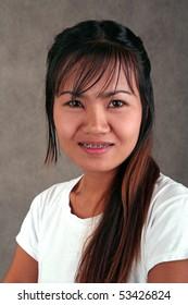 Thai girl with braces on her teeth