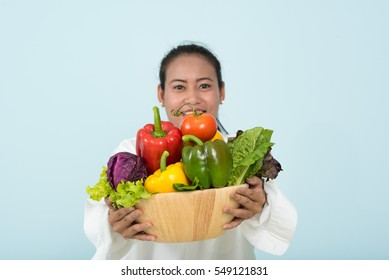Thai girl carry many vegetable in wood bowl