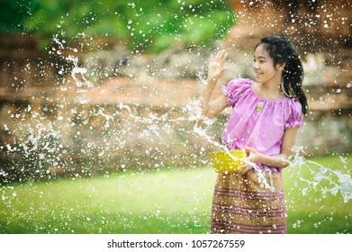 thai girl playing water in song kran festival at ayuthaya in thailand