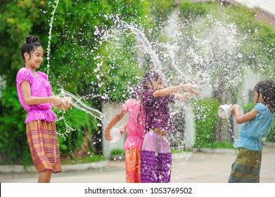thai girls children playing water in songkran festival with thai period dress
