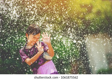 thai girls children playing water in songkran festival with thai period dress