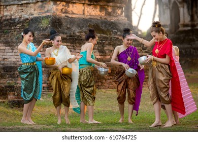 Thai girls and laos girls splashing water during festival 