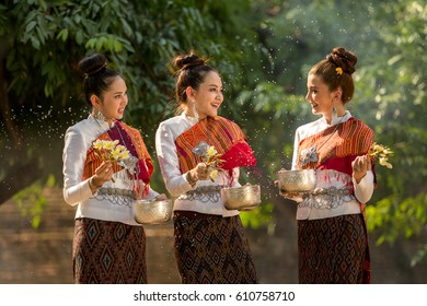 Thai girls splashing water during festival 