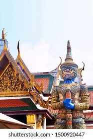 Thai Guardian Giant or Gate Guardian Holding Big Clubs at Wat Phra Kaew and The Grand Palace in Bangkok, Thailand. Symbol of Protection and Power.