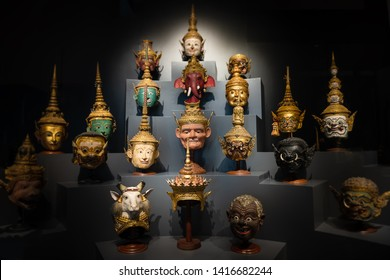 Thai handicraft mask head character from ramayana epic for thai khon art dancing collection set with dark background and low lighting.