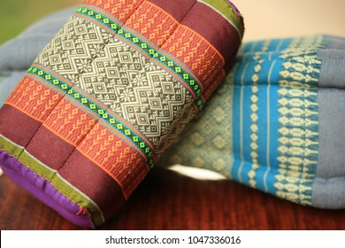 Thai handmade cotton pillow decorated on the table