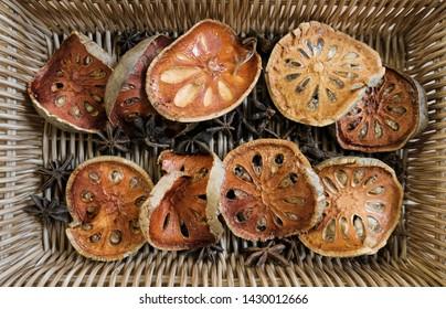 "Thai herb ""dry bael fruit"" on the basket"