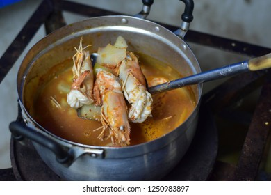 Thai homemade cooking ; sour soup made of tamarind paste with shrimp and fresh papaya that made by grandma