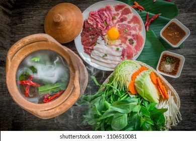 "Thai Hot Pot Recipe ""Jim Jum"" , clay pot.Thai traditional spicy shabu shabu, dipping meat in boiled spicy soup."