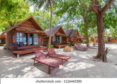 Thai house traditional style on white sand beach.