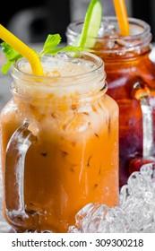 thai ice tea with milk and lemon tea in pitcher