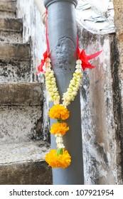 Thai jasmine garland for praying hanging on pole.