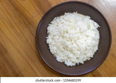 Thai jasmine rice on the wooden table.