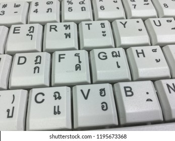 Thai keyboard display QWERTY and Thai Kedmanee layout closeup