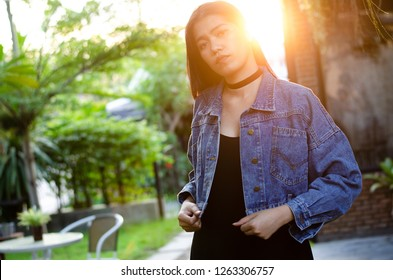 thai lady in black dress with jean jacket