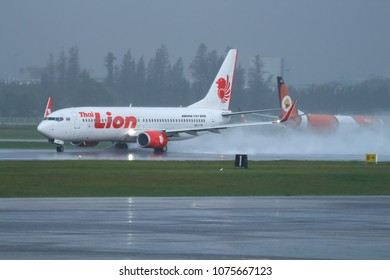 Thai Lion Air Boeing 737, registration HS-LUP, takes off from a wet runway of Donmueang International Airport (DMK/VTBD), Bangkok, Thailand, on 11 September 2017.