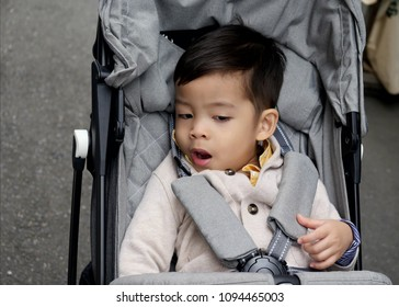 Thai little boy on a stroller, Traveling with parents to Kyoto Japan for vacation on May 14, 2018