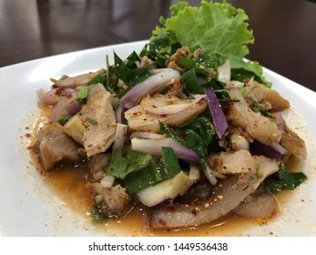 thai local Esaan foods originated from northeast of Thailand. hot and spicy grilled pork salad or Nam Tok Moo.
