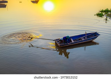 Thai local people controlling the helm of long-tailed boat to turn it and drive to the other bank on the river at sunset, people's way of life in contryside of Thailand
