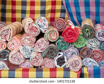 Thai loincloth roll for sale at the market in thailand. Thai loincloth is handmade from silk or cotton and the pattern same as check.