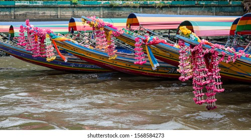 Thai long tail boats decorated with traditional flowers