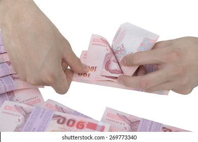 Thai Male hand counting pack of 100 baht banknote isolated on white