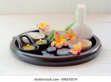 Thai massage, candle aromatherapy in Spa set on the white table, on soft background, in vintage color.