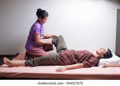 Thai massage leg stretching