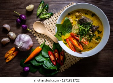Thai Meal Kit Green Curry Chicken.Thai food chicken green curry on dark wooden background. top view. Kaeng kheiyw hwan