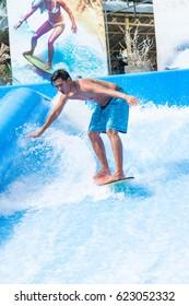 Thai men play surf board  outdoor.