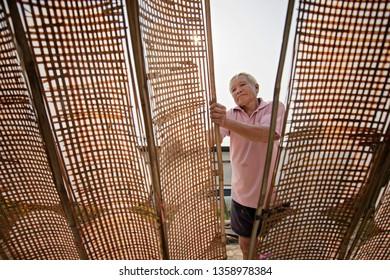 Thai men of Vietnamese descent making drying Vietnamese Rice Paper,Nongkhai,Thailand.