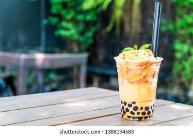 Thai milk tea with bubbles in cafe restaurant
