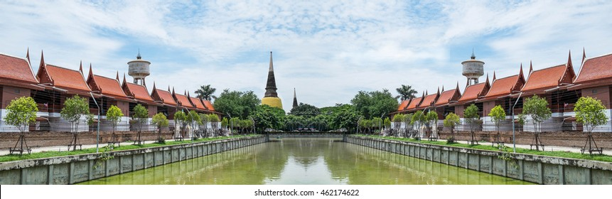 Thai modern brick house combine with Thai style wood roof located next to the lake on beautiful blue sky and cloud. Thai village Panoramic view.