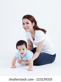 Thai mom and son smiling isolated