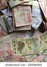 Thai money 100 Baht, 500 Baht and 1,000 Baht banknotes background