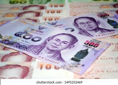 Thai money 500 baht and100 baht.Thai bank note background. Money background with thai five hundred baht . Business concept, finance.Thai Banknotes.