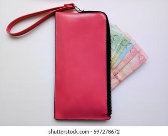 Thai money in a pink purse