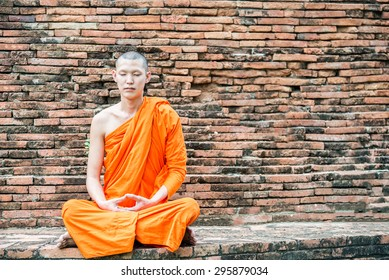 Thai monk meditation at temple in Ayutthaya, Thailand