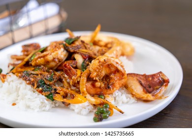 Thai most popular dish of normal meal is Pad Krapao seafood serve with rice