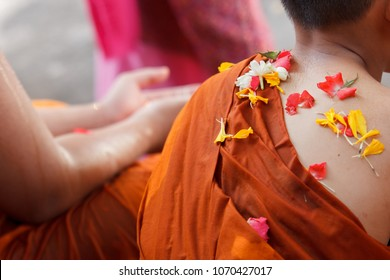 Thai New Year's national holiday, Songkran day, pouring water with fragrant and flowers for apologizing and get blessed to Buddhist monk hands and sometimes on neophyte shoulder.