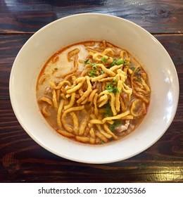 Thai noodle curry soup with pork