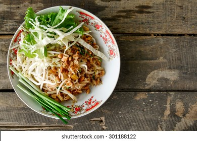 Thai noodle / pad Thai / fried noodle   on vintage wooden background