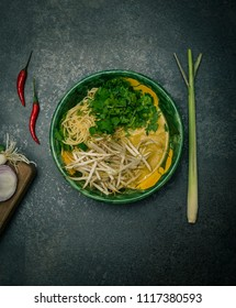 Thai noodle soup with coconut milk, lemon grass, turmeric and other spices.
