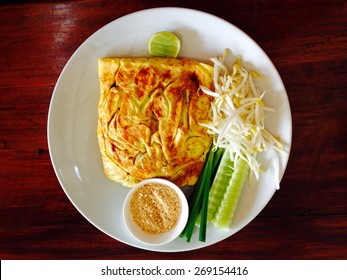 , thai noodle style. Special with egg fried and noodle inside on the wood desk.