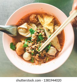 Thai noodle tomyum spicy in blow at street food