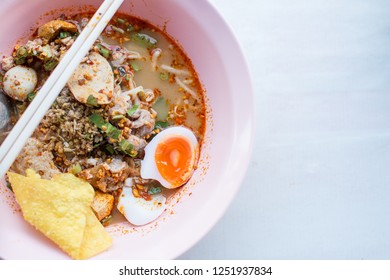 thai noodles tomyum with  soft boiled egg .