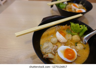 Thai noodles tomyum with soft boiled egg